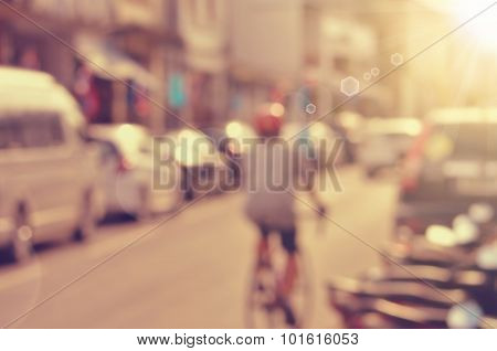 Blur Man Ride Bike In City Abstract Background.