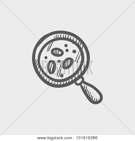 Microorganisms under magnifier sketch icon for web, mobile and infographics. Hand drawn vector dark grey icon isolated on light grey background.