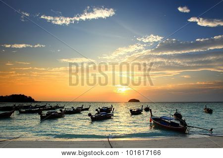 Beautiful Sunset And Thai Local Fishing Boats On Seaside At Lipe Island Beach Of The Andaman Sea, In