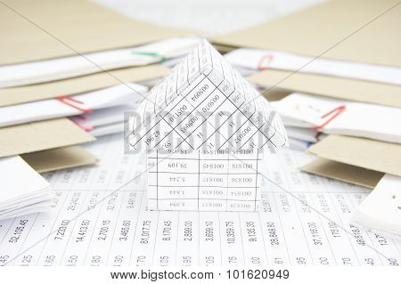 Close Up House Between Stack Paperwork Report With Envelope