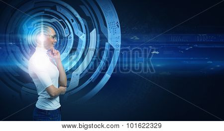 Young thoughtful woman and virtual blue interfase