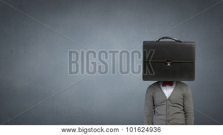 Unrecognizable businessman with suitcase instead of head