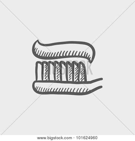 Toothbrush with toothpaste sketch icon forweb, mobile and infographics. Hand drawn vector dark grey icon isolated on light grey background.