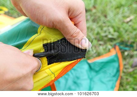 push the tent pole to socket of tent