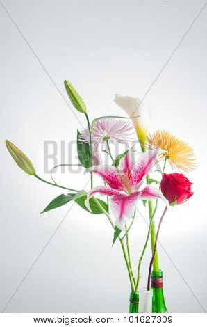 Detail of spring flowers bouquet isolated over white