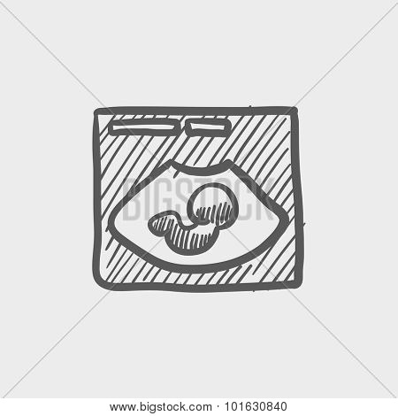 Fetal ultrasound sketch icon for web, mobile and infographics. Hand drawn vector dark grey icon isolated on light grey background.