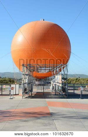 IRVINE, CA - FEBRUARY 15, 2015: Worker on the Balloon Ride at the Orange County Great Park. Maintenance worker preforms his duties atop the ride at the Orange County Great Park.