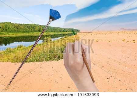 Hand With Paintbrush Paints River In Sand Desert