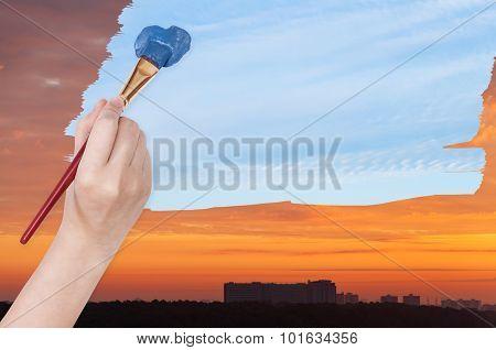 Paintbrush Paints Blue Day Sky On Orange Sunset
