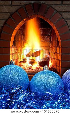 Blue Christmas Balls And Tinsel With Fireplace