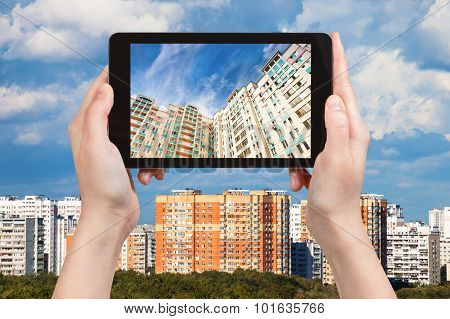 Photographs Picture Of Apartment Houses On Tablet