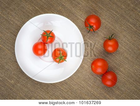 Ripe Fresh Cherry Tomatoes On White Plate
