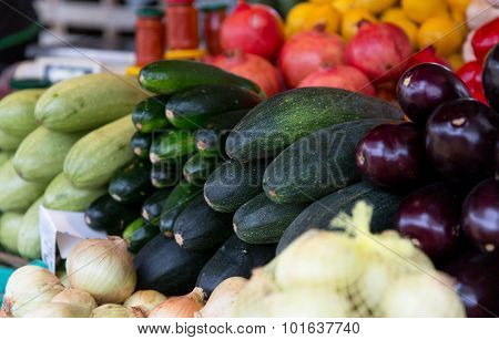 sale, harvest, food, vegetables and agriculture concept - close up of squash at street farmers market
