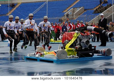 ST. PETERSBURG, RUSSIA - SEPTEMBER 9, 2015: Team Germany during competitions in combat deployment during the XI World Championship in Fire and Rescue Sport. First World Championship was held in 2002