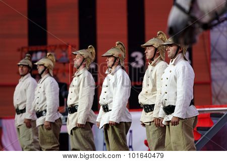 ST. PETERSBURG, RUSSIA - SEPTEMBER 7, 2015: Actors in historic costumes during the opening ceremony of the XI World Championship in Fire and Rescue Sport. First World Championship was held in 2002