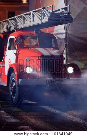 ST. PETERSBURG, RUSSIA - SEPTEMBER 7, 2015: Retro fire truck during the opening ceremony of the XI World Championship in Fire and Rescue Sport. First World Championship was held in 2002
