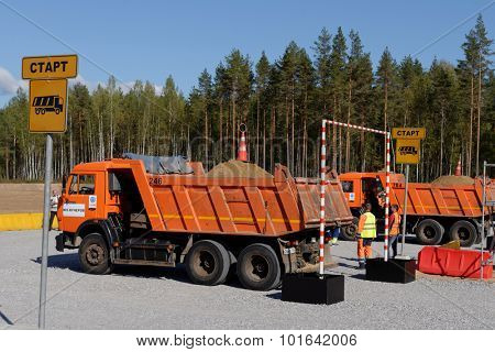 NOVOPRIOZERSK HIGHWAY, LENINGRAD OBLAST, RUSSIA - SEPTEMBER 11, 2015: Truck competitions during the final of the championship Worldskills Russia among road workers