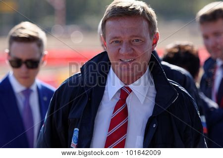 NOVOPRIOZERSK HIGHWAY, LENINGRAD OBLAST, RUSSIA - SEPTEMBER 11, 2015: Head of Rosavtodor Roman Starovoit during the opening of new stretch of Novopriozersk highway