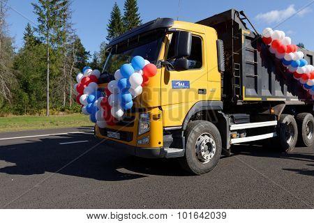 NOVOPRIOZERSK HIGHWAY, LENINGRAD OBLAST, RUSSIA - SEPTEMBER 11, 2015: First trucks passing on the new stretch of Novopriozersk highway. Construction began in 2013