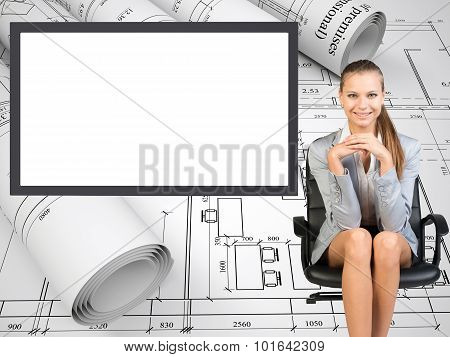 Happy business lady sitting in chair