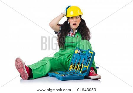 Female workman in green overalls with tool kit isolated on white