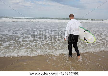 Groom At The Beach In Tuxedo Goes Surfing