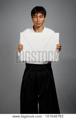 Smiling Man In Kimono With Card
