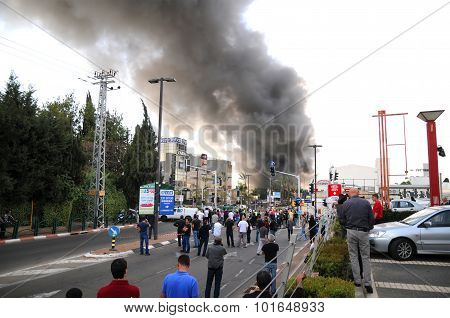 People watching huge smoke after a huge explosion in a big factory in the industrial area
