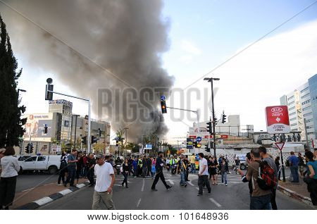 People watching huge smoke after a huge explosion in a big factory