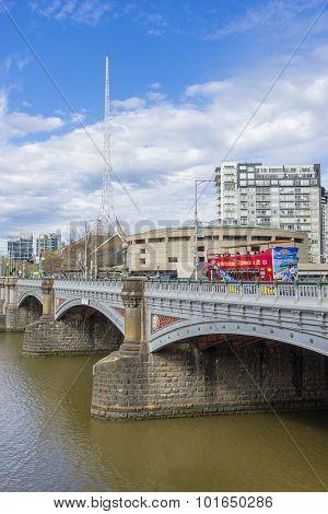 Melbourne Arts Centre Spire And Tourists On Tour Bus