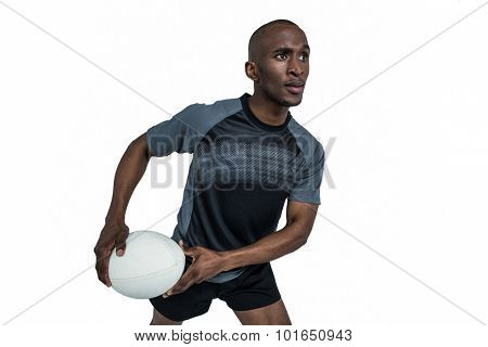 Confident athlete in position to throw rugby ball over white background