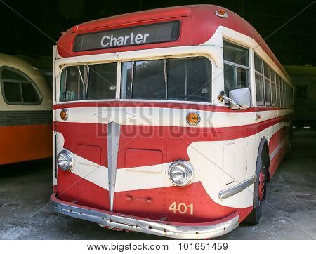 Old Red And White Charter Bus