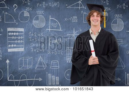 Smiling student in graduate robe against blue chalkboard