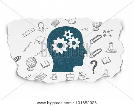 Learning concept: Head With Gears on Torn Paper background