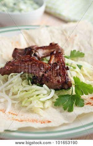 Gyro with lamb meat, cabbage, parsley, and tzatziki