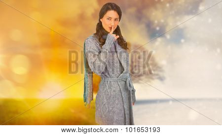 Young model with winter clothes keeping secret against autumn changing into winter