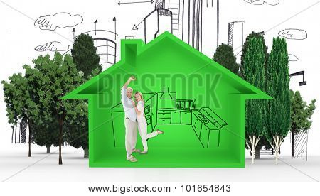 Portrait of cheerful couple against house shape with kitchen sketch