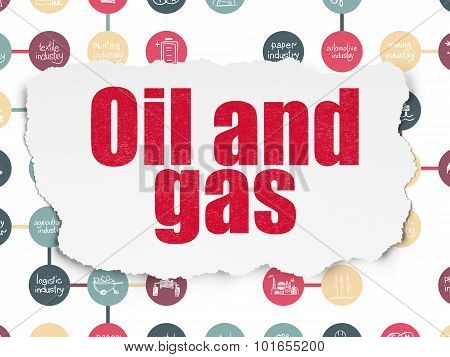 Manufacuring concept: Oil and Gas on Torn Paper background