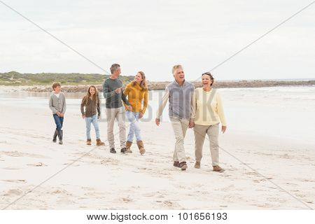 Multi generation family all together at the beach