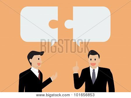 Two Businessman In Conversation
