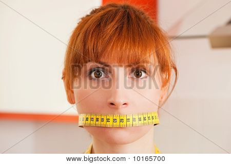 Woman gagged by a tape measure
