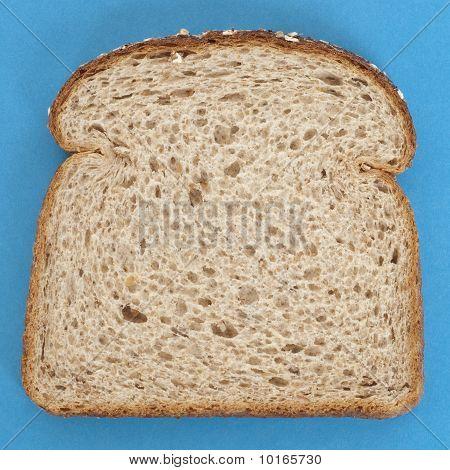 Slice Of Whole Grain Bread On Vibrant Blue