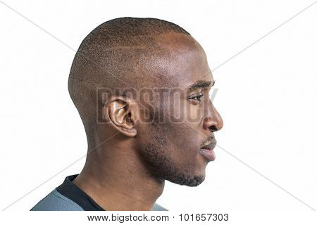 Profile view of confident sportsman against white background