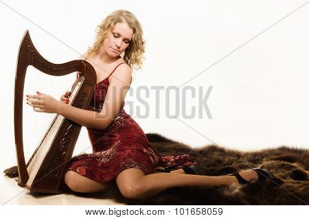 Blonde Woman With A Harp In His Hand