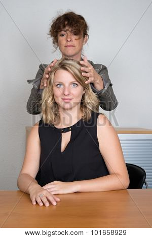 Professional Reiki Healer Doing Reiki Treatment To Young Woman