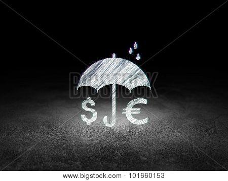 Insurance concept: Money And Umbrella in grunge dark room