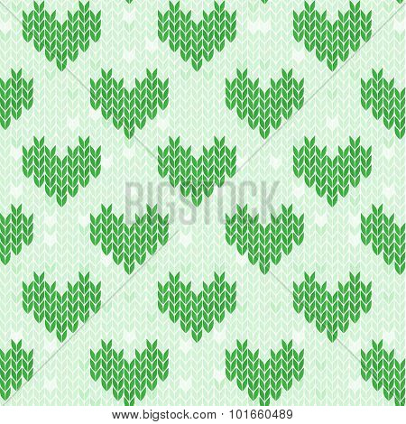 Seamless green pattern with knitted hearts