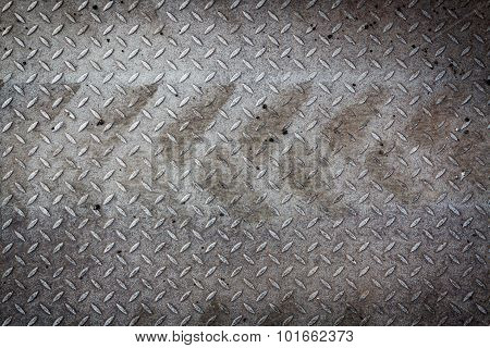 Dirty metal pattern and tyre tracks