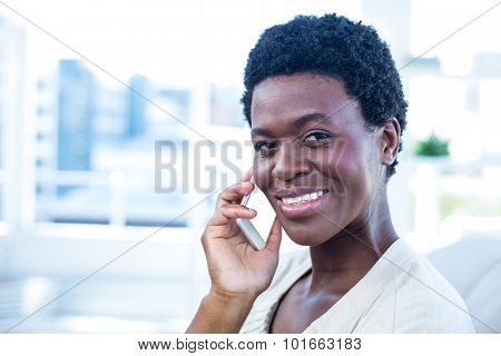 Portrait of woman with mobile phone at home
