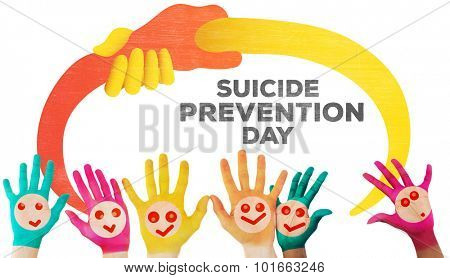 Hands with colourful smiley faces against suicide prevention day